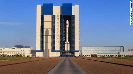 The Long March 2F carrier rocket is carried to the launch tower last week.