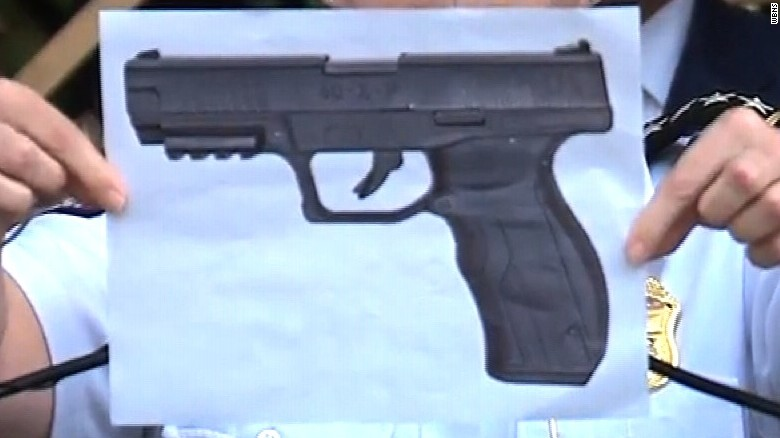 Columbus police Chief Kim Jacobs holds up a picture of what she says is a BB gun like Tyree King's.