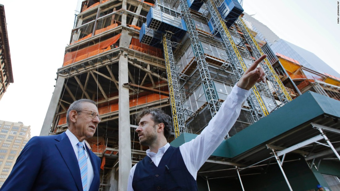 """Stephen Ross, (left) Chairman of Related Companies, talks with Thomas Heatherwick, the designer of the """"Vessel"""" sculpture, at Hudson Yards, Wednesday, Sept. 14, 2016 in New York."""