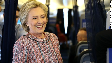 Democratic presidential nominee former Secretary of State Hillary Clinton speaks to members of the traveling press aboard her campaign plane at Westchester County Airport on September 15, 2016 in White Plains, New York.