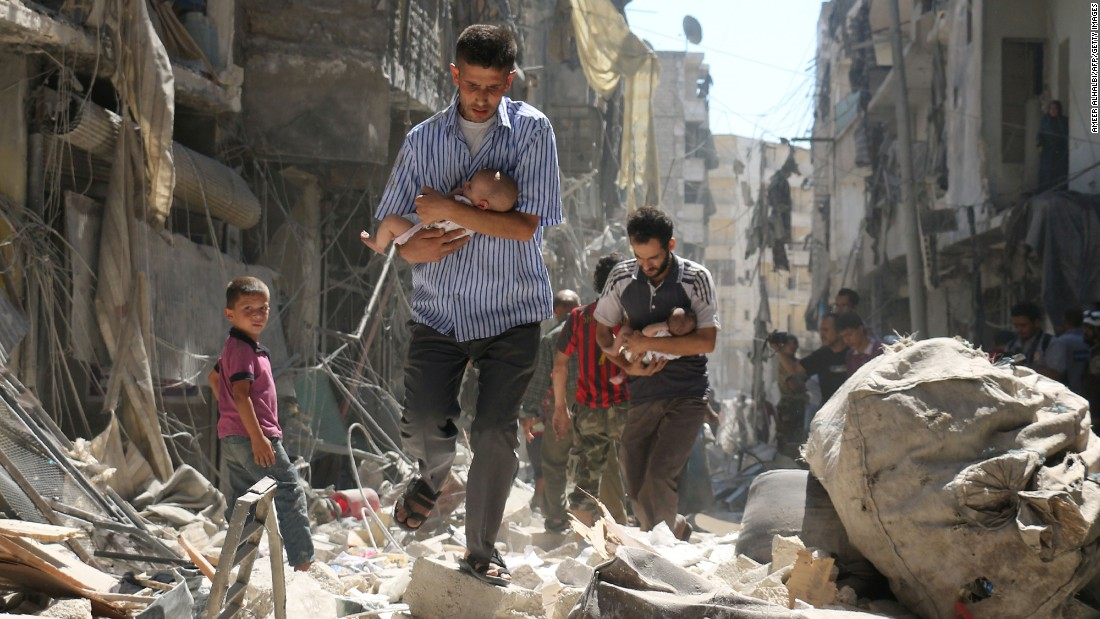 """People walk through the rubble following a reported airstrike in rebel-held Aleppo, Syria, on Sunday, September 11. The next day, the US and Russia <a href=""""http://www.cnn.com/2016/09/12/middleeast/syria-ceasefire-explained/"""" target=""""_blank"""">negotiated a ceasefire</a> aimed at ending the five-year Syrian civil war. As of Thursday, <a href=""""http://www.cnn.com/2016/09/15/middleeast/syria-ceasefire/index.html"""" target=""""_blank"""">at least 23 people were killed</a> during airstrikes in the country, and both the US and Russia have accused each other of violating their ceasefire obligations."""
