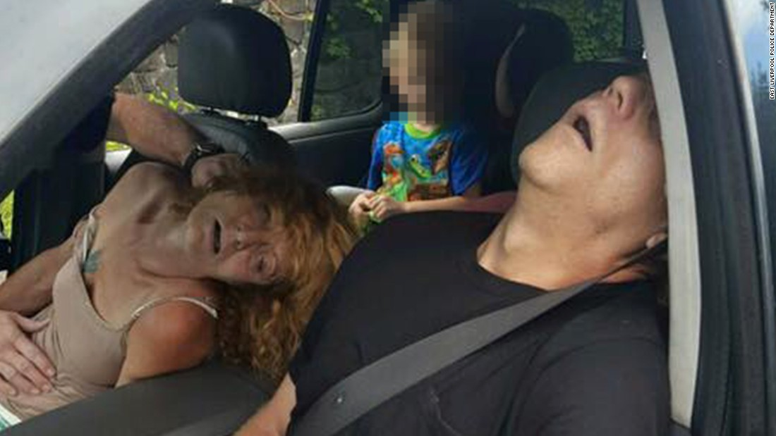 """A woman and man in East Liverpool, Ohio, are seen passed out from a drug overdose as a child sits in the back seat of a car on Wednesday, September 7. The East Liverpool city administration <a href=""""https://www.facebook.com/cityofeastliverpool/posts/879927698809767"""" target=""""_blank"""">posted the photo on Facebook</a>, along with one other image, in order to show the <a href=""""http://www.cnn.com/2016/09/09/health/heroin-effects-police-photo-trnd/"""" target=""""_blank"""">devastating effects of heroin addiction</a>. Rhonda Pasek, the child's grandmother who is seen in the photo, has been <a href=""""http://www.cnn.com/2016/09/15/health/heroin-photo-woman-court/index.html"""" target=""""_blank"""">sentenced to 180 days in jail</a> and ordered to pay $280 in fines after pleading no contest to endangering a child and disorderly conduct and public intoxication.. <em>Editor's note: A portion of this photo has been blurred by CNN because of the age of the subject.</em>"""