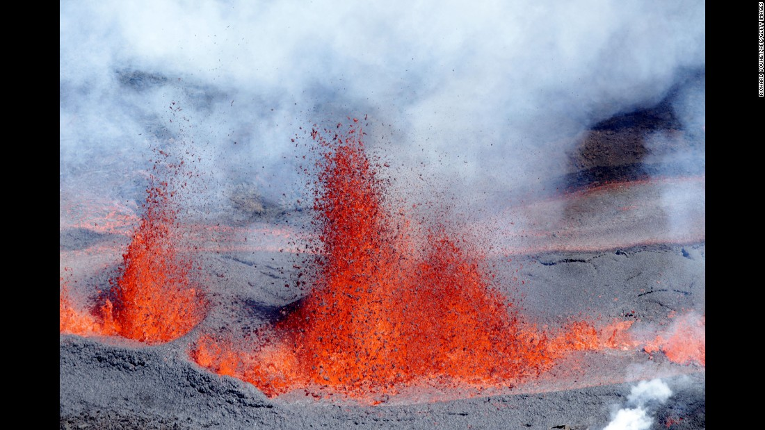 """Lava sprays from the """"Peak of the Furnace"""" volcano on Reunion island, a French region, on Sunday, September 11."""