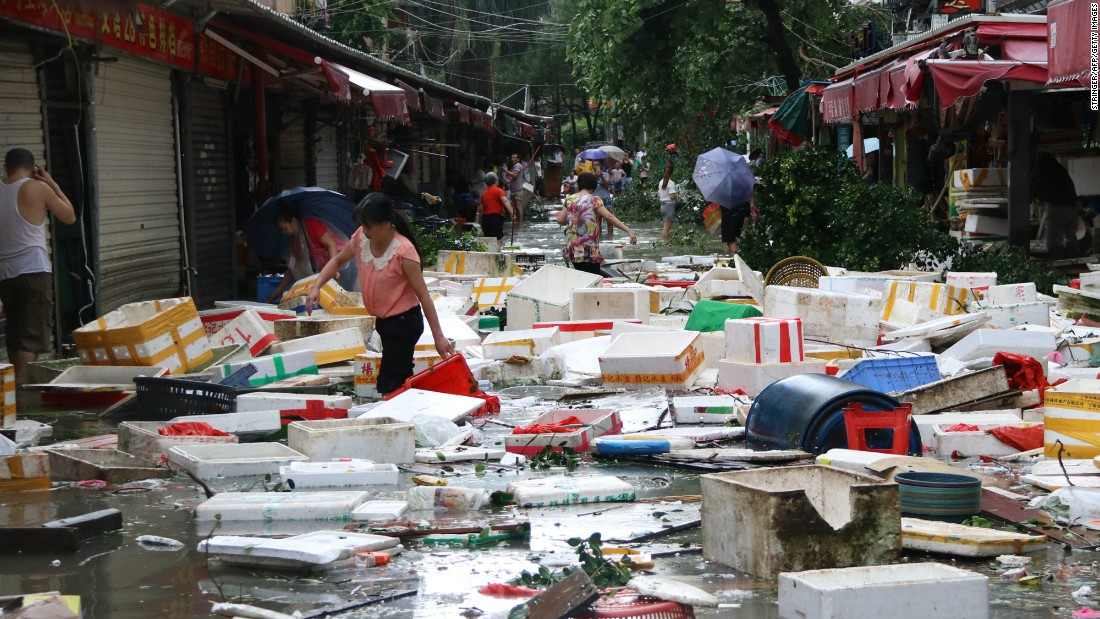 """Residents make their way through a flooded street in Xiamen, China, on Thursday, September 15. Typhoon Meranti <a href=""""http://www.cnn.com/2016/09/14/asia/typhoon-meranti-weather/"""" target=""""_blank"""">made landfall</a> and is the strongest tropical storm since Typhoon Haiyan hit the Philippines in 2013."""