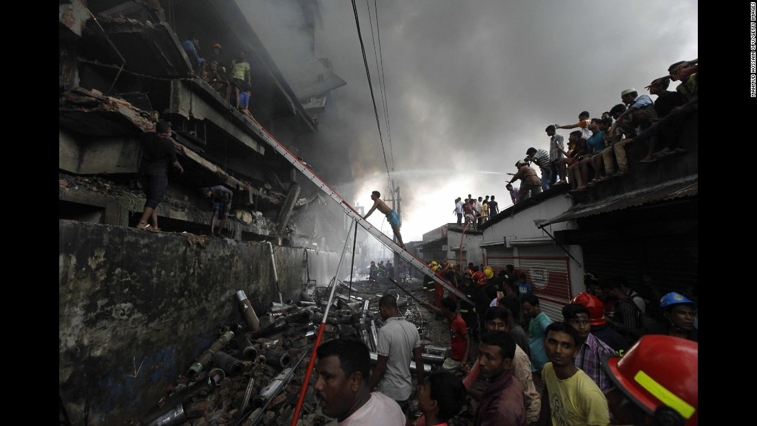 """Firefighters attempt to extinguish a fire at a garment packaging factory in Tongi, Bangladesh, on Saturday, September 10. At least 23 people were killed after an explosion in the boiler room of the factory, <a href=""""http://www.bbc.com/news/world-asia-37327033"""" target=""""_blank"""">according to the BBC</a>."""