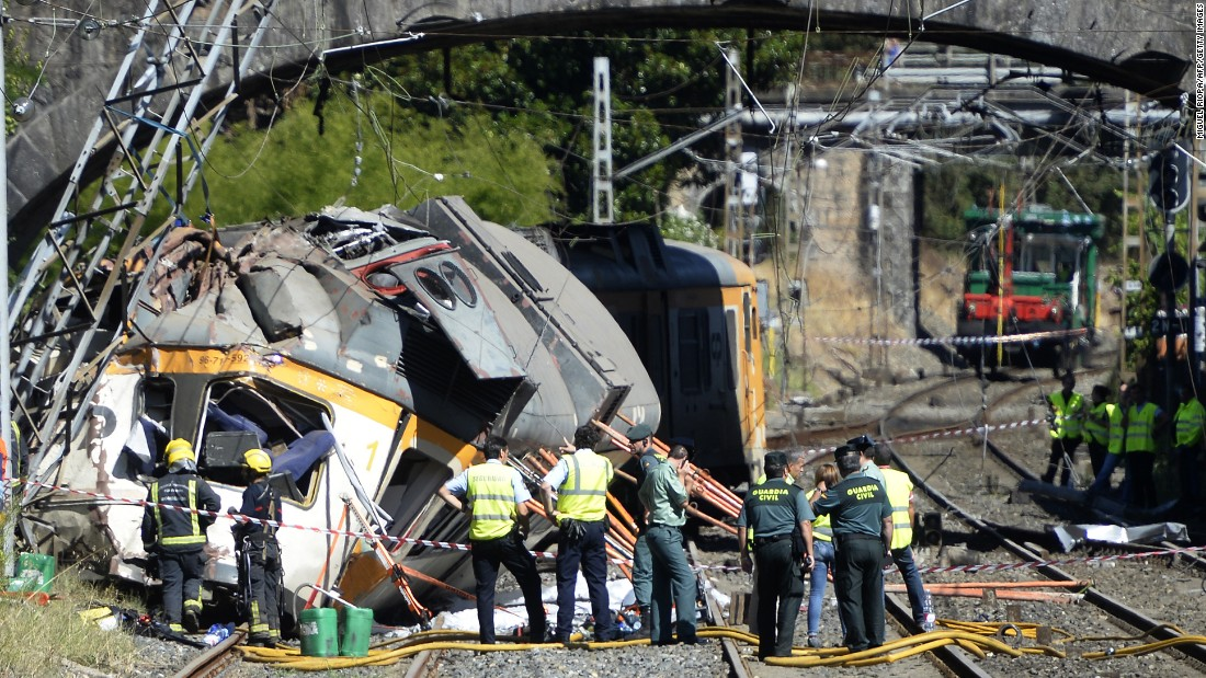 """Spanish police officers, firefighters and security members inspect the wreckage of a <a href=""""http://www.cnn.com/2016/09/09/europe/spain-train-crash-vigo/"""" target=""""_blank"""">train that derailed</a> in O Porrino, Spain, on Friday, September 9. At least four people were killed and nearly 50 were injured."""