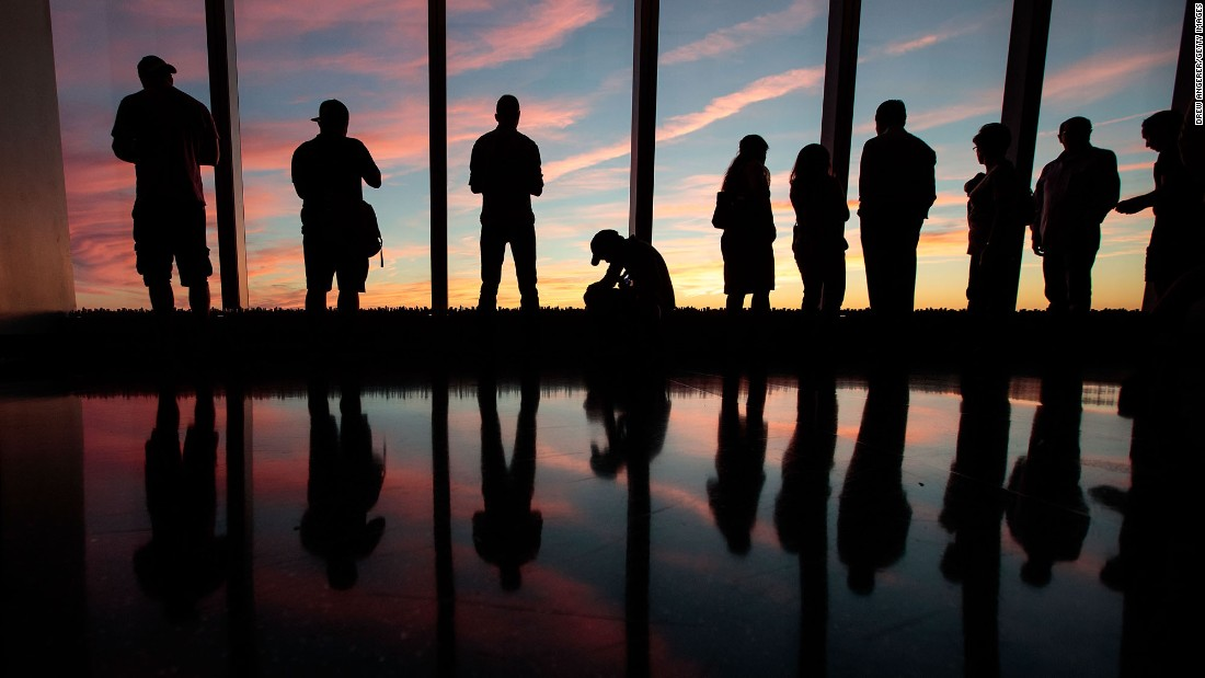 """People watch the sunset from the One World Observatory in New York on Sunday, September 11. <a href=""""http://www.cnn.com/2016/09/08/world/gallery/week-in-photos-0909/index.html"""" target=""""_blank"""">See last week in 34 photos </a>"""