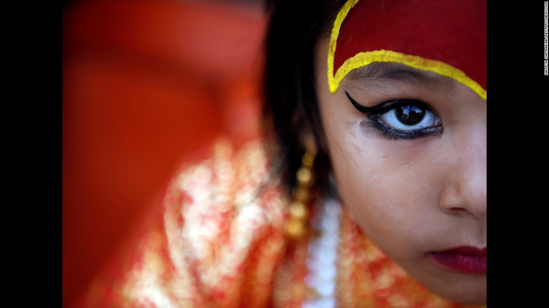 """A child dressed as the goddess Kumari takes part in the Kumari Puja festival in Kathmandu, Nepal, on Wednesday, September 14. Kumari means """"virgin"""" and is a Hindu tradition where young pre-pubescent girls are worshipped."""
