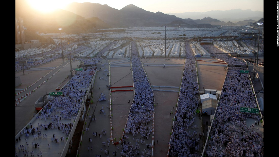 """Muslims make their way to the """"stoning of the devil"""" during the holy <a href=""""http://www.cnn.com/2016/09/09/middleeast/hajj-2016-saudi-arabia/"""" target=""""_blank"""">Hajj pilgrimage</a> on the first day of Eid al-Adha near Mecca, Saudi Arabia, on Monday, September 12. The """"stoning of the devil"""" is a key ritual where pilgrims throw stones at three pillars known as the """"Jamarat,"""" symbolizing the rejection of the devil's temptation."""