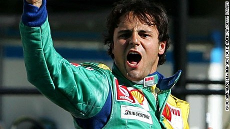 SAO PAULO, BRAZIL - OCTOBER 22:  Felipe Massa of Brazil and Ferrari  celebrates winning the Brazilian Formula One Grand Prix at the Autodromo Interlagos on October 22, 2006 in Sao Paulo, Brazil.  (Photo by Paul Gilham/Getty Images)