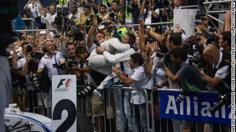 Massa celebrates his sole runner-up finish at Williams with the team's technical staff.