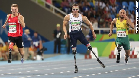 Left to right: Daniel Wagner of Denmark, Richard Whitehead of Great Britian and Scott Reardon of Australia competes in the 100m T42 final.