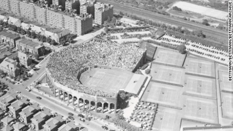 (Original Caption) A striking air view of the West Side Tennis Stadium in Forest Hills, Long Island, jammed to capacity with 14,000 tennis fans watching one of the semifinals matches in the National Singles Tennis Championships, on September 19th, Tennis tradition clings to the stadium just as surely as does the ivy which appears as dark patches in the picture. The stadium and grounds form an oasis in a residential area of Forest Hills.