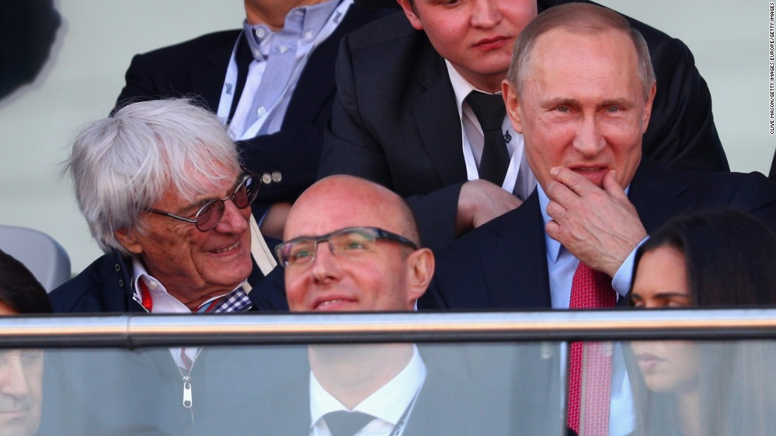 The former used car salesman rubs shoulders with some of the world's most powerful men, among them Russian leader Vladimir Putin (right).