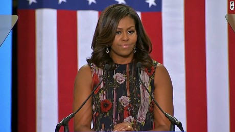 Image result for Michelle Obama calls out 'birtherism' at campaign stop for Clinton