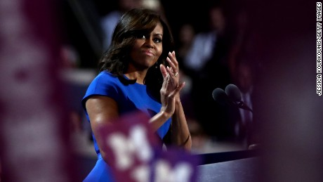 First lady Michelle Obama acknowledges the crowd during her speech on the first day of the Democratic National Convention at the Wells Fargo Center, July 25, 2016 in Philadelphia, Pennsylvania.