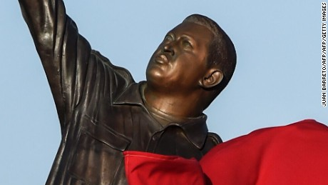 A statue of late Venezuelan President Hugo Chavez is unveiled during a demonstration by supporters if the ruling party, in Porlamar, Margarita Island, Venezuela, on September 16, 2016 ahead of the Non-Aligned Movement summit here. Left increasingly isolated by a crushing political and economic crisis, Venezuela will seek the support of old friends when it hosts a summit of the Non-Aligned Movement this weekend. / AFP / Juan BARRETO        (Photo credit should read JUAN BARRETO/AFP/Getty Images)