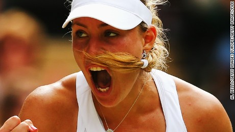 LONDON, ENGLAND - JULY 01:  Angelique Kerber of Germany celebrates during her Ladies' Singles fourth round match against Maria Sharapova of Russia on day eight of the Wimbledon Lawn Tennis Championships at the All England Lawn Tennis and Croquet Club on July 1, 2014 in London, England.  (Photo by Al Bello/Getty Images)