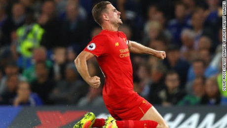 Jordan Henderson celebrates his goal in Liverpool's 2-1 victory over Chelsea.