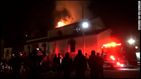 Flames engulf the church's roof in video from Peru TV network Andina.