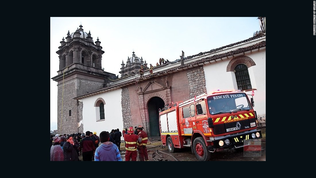 Officials assess the damage to the San Sebastian Church in Cusco, Peru, after a devastating fire Friday, September 16.
