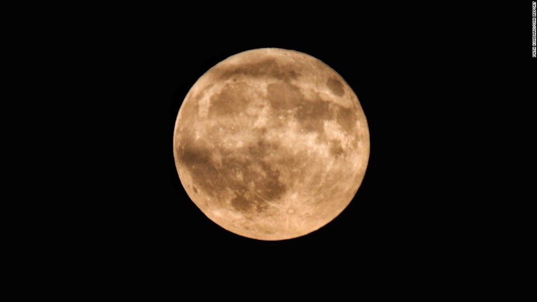 """With a beautiful full moon that was glowing orange on a clear night, I had to take advantage and get some photos,"" Faith Konidaris of Pittsburgh says."