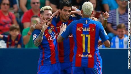 Lionel Messi celebrates Barcelona's opening goal with Luis Suarez and Neymar.