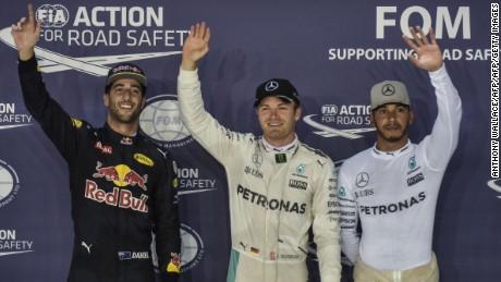 Nico Rosberg, Daniel Ricciardo and Lewis Hamilton celebrate their top three finish in Singapore GP qualifying.