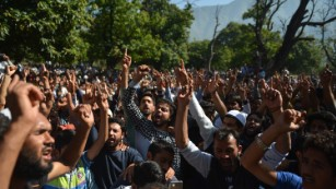Kashmiri mourners shout slogans at a funeral in Srinagar on September 17, 2016.
