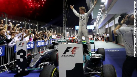 Nico Rosberg celebrates his superb victory at the Singapore Grand Prix -- his third in a row