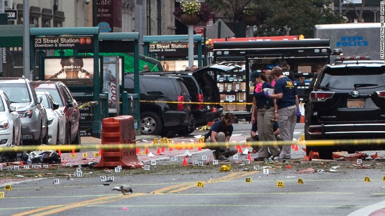 FBI agents review the scene of the explosion Sunday morning.