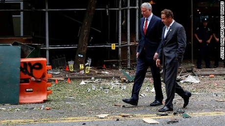New York Mayor Bill de Blasio and New York Governor Andrew Cuomo tour the site of an explosion that injured 29 people in New York City's Chelsea neighborhood.