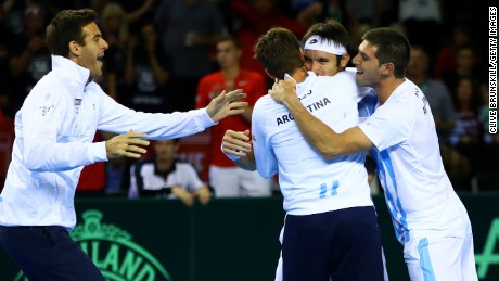 Leonardo Mayer of Argentina celebrates with his team-mates, Juan Martin del Potro, Guido Pella and Federico Delbonis, after winning his deciding singles match against Dan Evans of Great Britain in Glasgow.