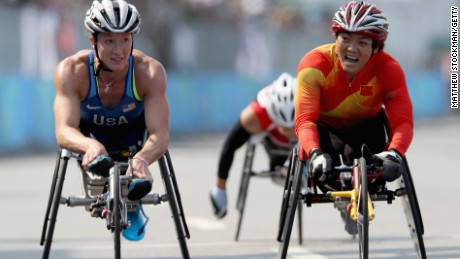 Tatyana McFadden of the USA is edged out at the finish by Lihong Zou of China.