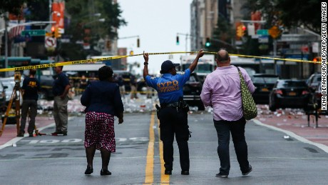 Law Enforcement Officers are seen at the scene of an explosion on West 23rd Street September, 18, 2016 in New York. An explosion rocked one of the most fashionable neighborhoods of New York on September 17 night, injuring 29 people, one seriously, a week after America's financial capital marked the 15th anniversary of the 9/11 attacks. Mayor Bill de Blasio indicated the blast was not accidental, even if there was no known link to terrorism. The blast occurred in Chelsea -- an area packed with bars, restaurants and luxury apartment blocks -- at a typically bustling time of the weekend / AFP / KENA BETANCUR        (Photo credit should read KENA BETANCUR/AFP/Getty Images)
