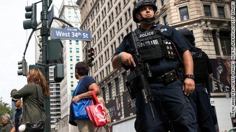 NEW YORK, NY - SEPTEMBER 18: A member of the New York City Police Department stands guard in Herald Square, September 18, 2016 in New York City. Following Saturday night's explosion in the Chelsea neighborhood of Manhattan, Mayor Bill de Blasio has promised a 'substantial' police presence throughout the week. New York Governor Andrew Cuomo also said an additional 1,000 New York State and National Guard troops will patrol transit stations and airports as a precaution. (Photo by Drew Angerer/Getty Images)