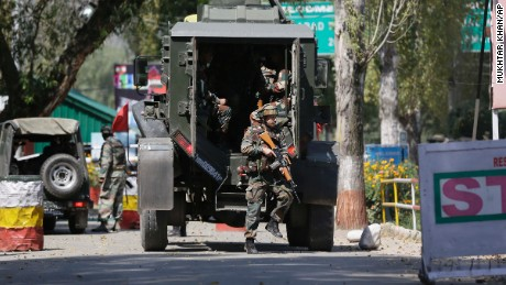 Indian army soldiers arrive at the army base which was attacked by suspected rebels in the town of Uri, west of Srinagar, Indian-controlled Kashmir, on Sunday, Sept. 18, 2016.