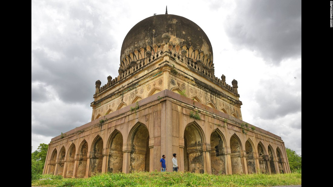 Visitors are dwarfed by the tomb of Sultan Muhammad Qutb Shah. The granite tombs have distinctive appearances, fusing elements of Persian, Hindu and Pathan architectural styles.