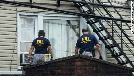 ELIZABETH, NJ - SEPTEMBER 19: Members of the Federal Bureau of Investigation (FBI) and other law enforcement officials investigate a residence in connection to Saturday night's bombing in Manhattan, September 19, 2016 in Elizabeth, New Jersey. On Monday morning, law enforcement released a photograph of 28-year-old Ahmad Khan Rahami, who they are seeking in connection to the attack. (Photo by Drew Angerer/Getty Images)