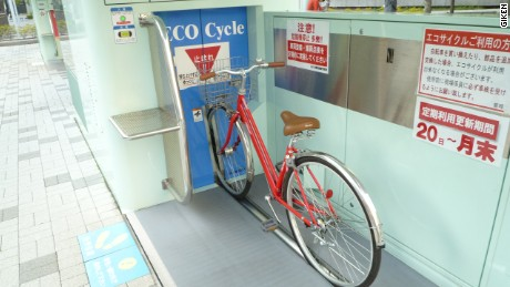 To load a bike at an Eco Cycle unit, cyclists simply need to place the bike on a metal rods -- and the automated system does the rest.