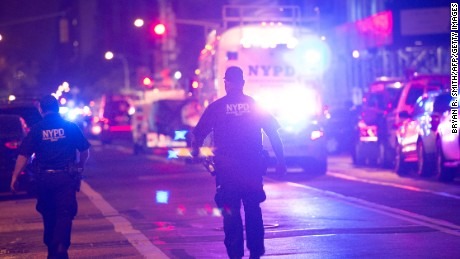 TOPSHOT - Police and first responders walk down a blocked off road near the site of an alleged bomb explosion on West 23rd Street on September 17, 2016, in New York. An explosion in New York's upscale and bustling Chelsea neighborhood injured at least 25 people, none of them in a life-threatening condition, late Saturday, the fire department said. / AFP / Bryan R. Smith        (Photo credit should read BRYAN R. SMITH/AFP/Getty Images)