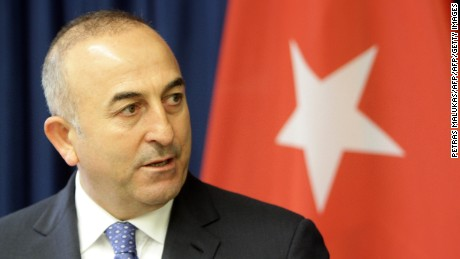 """Turkish Foreign Minister Mevlut Cavusoglu gives a press conference with his Lithuanian counterpart (not in picture) in Vilnius on April 3, 2015. Cavusoglu said Turkey will send and """"informal mission"""" to Crimea to monitor what it termed the """"oppression"""" of Crimean Tatars, an ethnic group that opposed Russia's 2014 seizure of the Black Sea peninsula.      AFP PHOTO / PETRAS MALUKAS        (Photo credit should read PETRAS MALUKAS/AFP/Getty Images)"""