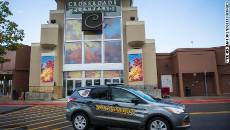 "ST CLOUD, MN - SEPTEMBER 19: Security car patrols outside the Crossroads Center mall  that reopens today has been closed since Saturday night when a man entered and stabbed nine people on September 19, 2016 in St Cloud, Minnesota. The FBI is investigating the knife attacks as ""a potential act of terrorism."" Nine people were injured by an attacker who was killed inside the Macy's store by an off-duty Avon police officer."