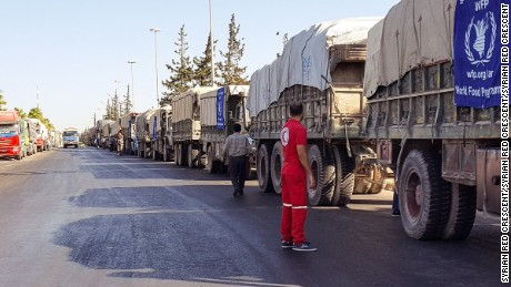 Syrian Red Crescent delivering aid convoy of 31 trucks heading out to reach the western rural side of Aleppo (before being attacked by airstrikes).