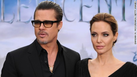 """Brad Pitt and Angelina Jolie attend a private reception as costumes and props from Disney's """"Maleficent"""" are exhibited in support of Great Ormond Street Hospital at Kensington Palace on May 8, 2014 in London, England."""