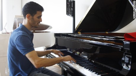 Aeham Ahmad practices at a piano shop in his adopted hometown of Wiesbaden, Germany.