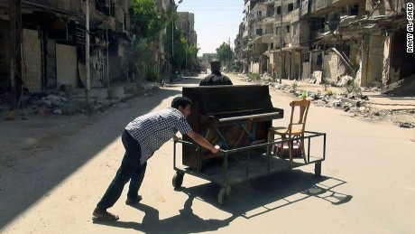 Aeham pushed his piano through the streets of Yarmouk to entertain residents of the besieged area.