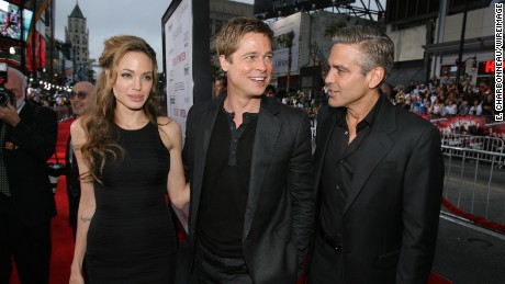 Angelina Jolie, Brad Pitt and George Clooney (Photo by Eric Charbonneau/WireImage for Warner Bros.)