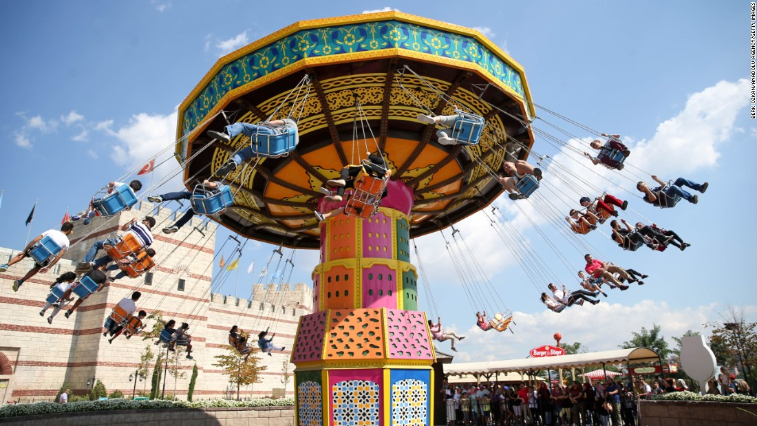 Eid Al-Adha is a festival of fun as well as significant day in the Muslim calendar. In Istanbul, it's an excuse to hit the rides, including this colorful retro swing spinner, at an amusement park.