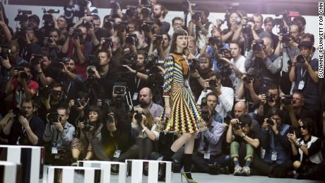 Photographers shoot the Marry Katrantzou catwalk show during London Fashion Week, September 18, 2016.